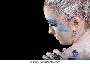 face art - close-up profile of caucasian young woman with...