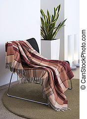 Plaid draped over a chair