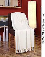 White throw draped over a chair
