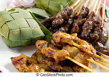 Chicken and Lamb Satay Skewers with Ketupat Rice Wrapped in...