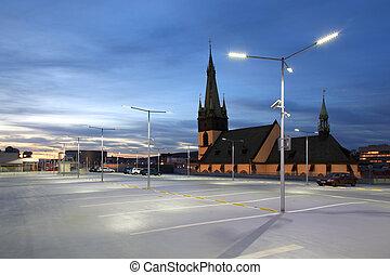 Car park at dusk - Empty car park illuminated by street...