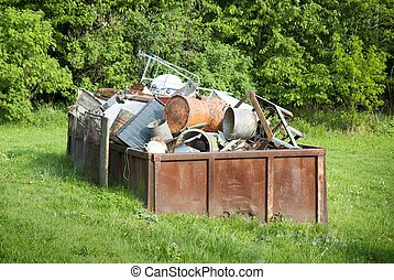Waste container - Rusty waste container full of scrap metal...