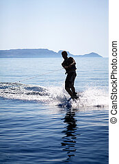 Wakeboarder Silhouette - Silhouette of a wakeboarder in...