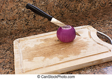 Purple Onion - Purple salad onion on the cutting board