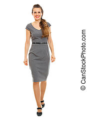 Full length portrait of business woman making first step