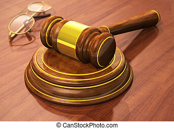 Wooden gavel and eyeglasses on table