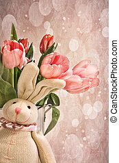 Stuffed rabbit with tulips for easter