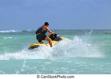man drive on the jetski - Man on Wave Runner turns fast on...