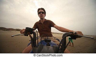 Man Drives Quad At Beach