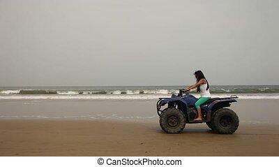 Woman On Qaud At Beach