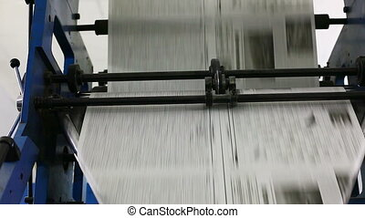 black and white newspaper production line