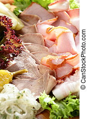 cold cuts - Fresh cold cuts on the wooden plate