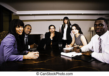 Board Room - A group of emplyees sitting around a table.