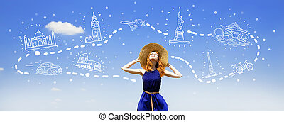 Redhead girl dreaming about traveling around the world.