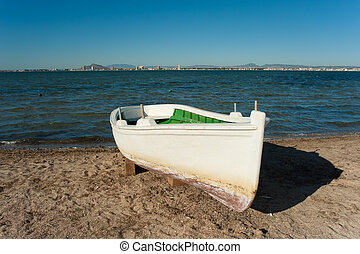 Mar Menor - A traditional fishing boat resting on a Mar...
