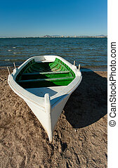 White boat - White fishing boat resting on a Mediterranean...