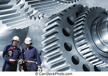 engineering and technology - two engineers with large gears...