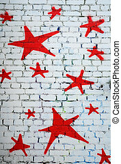Red Stars on White Brick Wall - Red stars on the white brick...
