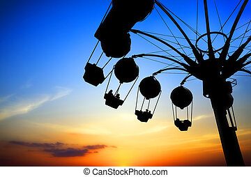 Amusement park at sunset