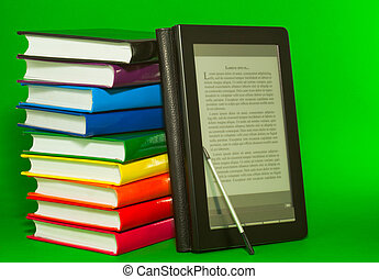 E-book reader with stack of printed books