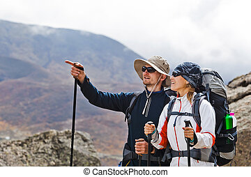 Couple Hiking in Himalaya Mountains - Couple hiking in...