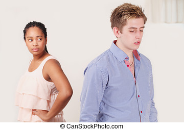 Couple dispute unhappiness - Diverse young couple in dispute...