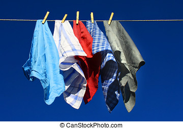 handkerchiefs,laundry hanging on clothesline against blue...