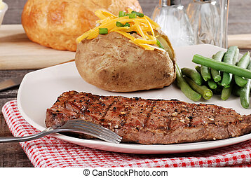 Barbecue steak with baked potato