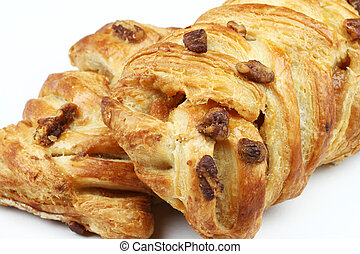 Pecan pastries - Close-up of two pastries filled by honey...