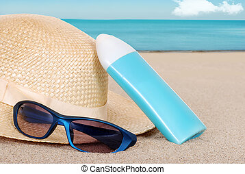 suntan lotion hat focus on glasses - closeup suntan lotion...