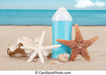 Suntan lotion with shells on beach - closeup Suntan lotion...