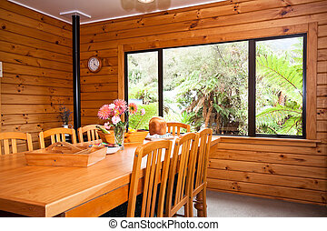 Interior detail of wooden lodge dining room - Nice warm...