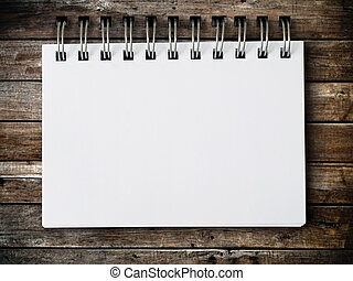 blank note paper on wood panel