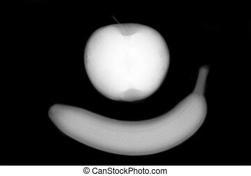 Apple and banana are scanned by X-ray - An apple and banana...