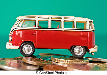 car on the pile of coins - small red car on the pile of...
