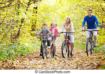 Cyclists - Family on bikes in the park