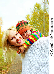 happy mother and son - happy young beautiful mother giving...