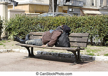 Homeless sleeping on the bench