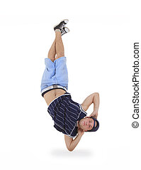 young male dancer performing a bboying stunt