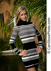 Confident Beauty in a sweater dress - Beautiful young woman...