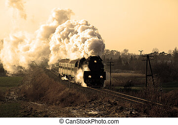 Old retro steam train - Vintage steam train passing through...