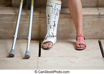 Woman with leg in plaster - A Woman with leg in plaster and...