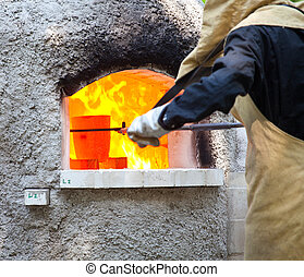 Hot melting glasses - Workers during the Glass processing -...