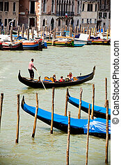 Gondolas parking traditional Venetian rowing boat in Italy