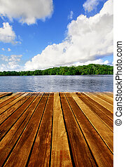 Wooden pier boardwalk - Wooden brown boardwalk on a lake...