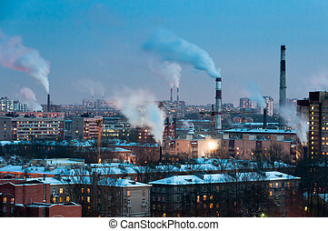 Pipes in industrial district make smoke, Saint-Petersburg,...