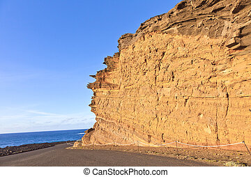 volcanic stone formation with blue sky at el Golfo, Lanzarote