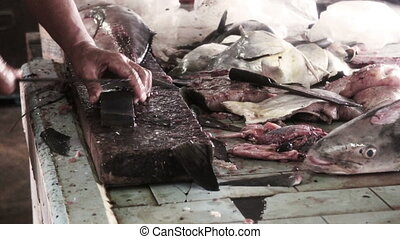 Sharpening knife in Wet Fish Market