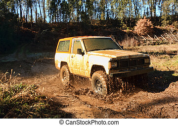 Jeep adventure race - A jeep speeding along river and mud...