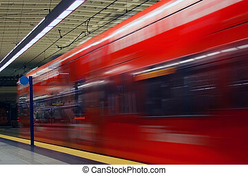 Metro Tunnel #3 - Red colored light rail car passing by in a...
